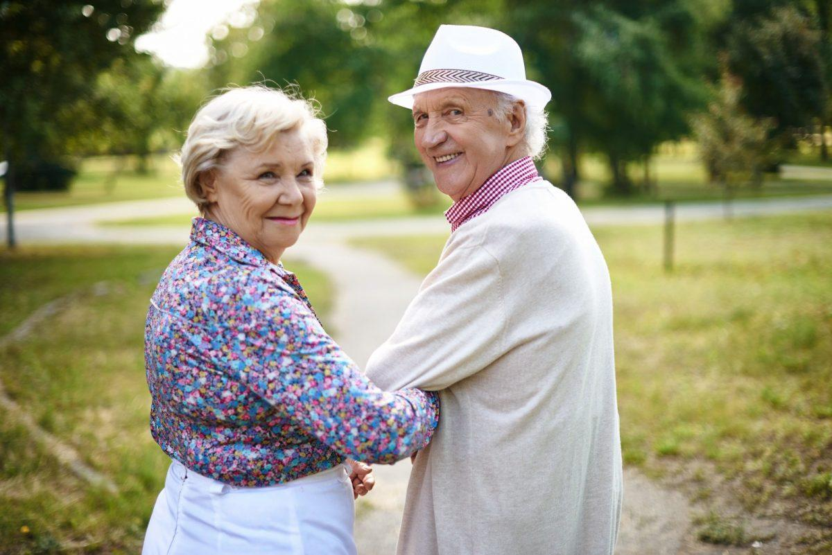 graphicstock happy senior couple looking at camera during walk rX s7q8fEW